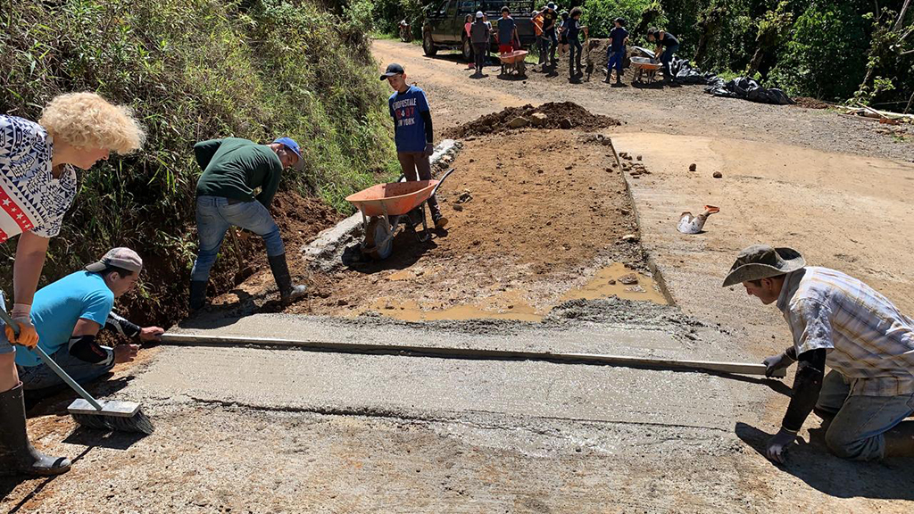 Leveling the new paved road in Costa Rica